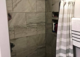 These 12x24 tiles give this smaller shower a bigger feel!